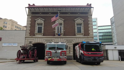 Rosenbauer showcases the Revolutionary Technology (RT), America's first electric fire truck (pictured right) in Washington, D.C. Shown alongside an antique steam engine (pictured left) and a current fire apparatus (pictured center), the Rosenbauer RT is one of the most notable innovations in the fire industry.