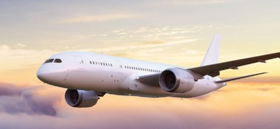 Photo of passenger jet flying above the clouds at dusk (CNW Group/Unifor)