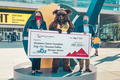 Mountain America's President and CEO, Sterling Nielsen, presents a $62,000 check to Dr. Beckerle, CEO at Huntsman Cancer Institute, during the May 8 Utah Jazz game.
