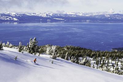 Skier in fresh powder overlooking Lake Tahoe in Heavenly, CA. Source: Danhoun