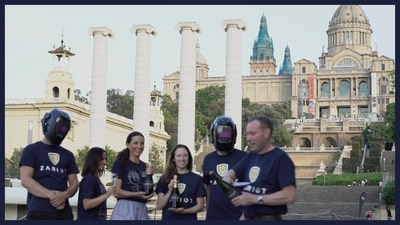 ZARIOT team celebrates GLOMO win, with company tradition of sabering a champagne bottle, in front of the iconic old MWC Fira in Barcelona, Spain
